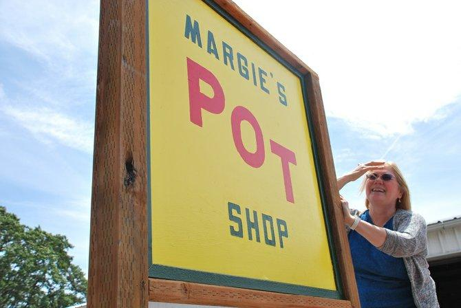Margie Lemberger stands in front of her store in Bingen, Washington.