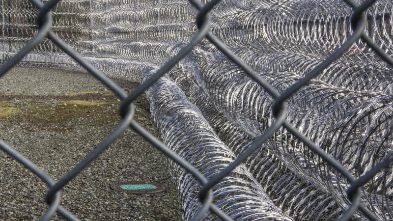 Layers of barbed wire surround Washington's Monroe Correctional Complex.