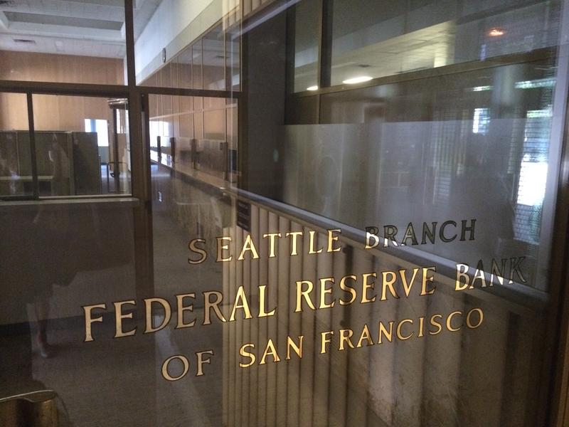 Seattle Public Schools officials will apply to open a school in the former Federal Reserve Bank building in downtown Seattle.
