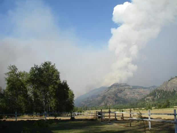 Plumes of smoke rise from the Devil's Elbow Complex fire on the Colville Indian Reservation.