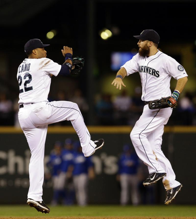 Dustin Ackley and Robinson Cano celebrate after the Mariners beat the Toronto Blue Jays 6-3 on Tuesday, Aug. 12, 2014, in Seattle.