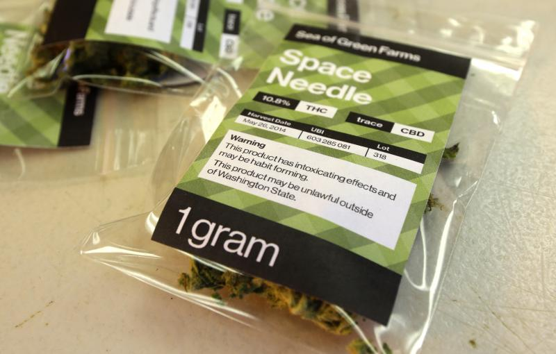 "In this photo taken July 1, 2014, a one-gram packet of a variety of recreational marijuana named ""Space Needle"" is shown during packaging operations at Sea of Green Farms in Seattle."