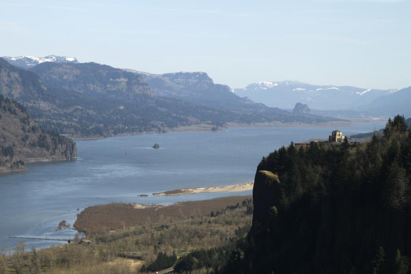 FILE - In this March 7, 2012, file photo, the Columbia River flows past the Vista House on Crown Point at right near Corbett, Oregon.