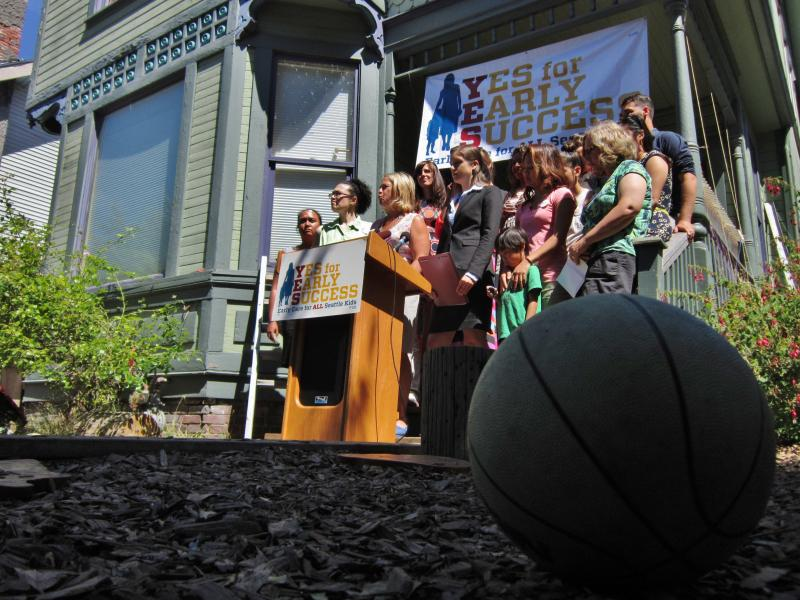 Supporters of Initiative 107 hold a press conference in Seattle's Central District on July 31, 2014. They sued the city in hopes of giving voters the chance to approve both their ballot proposal and the city's preschool pilot plan.