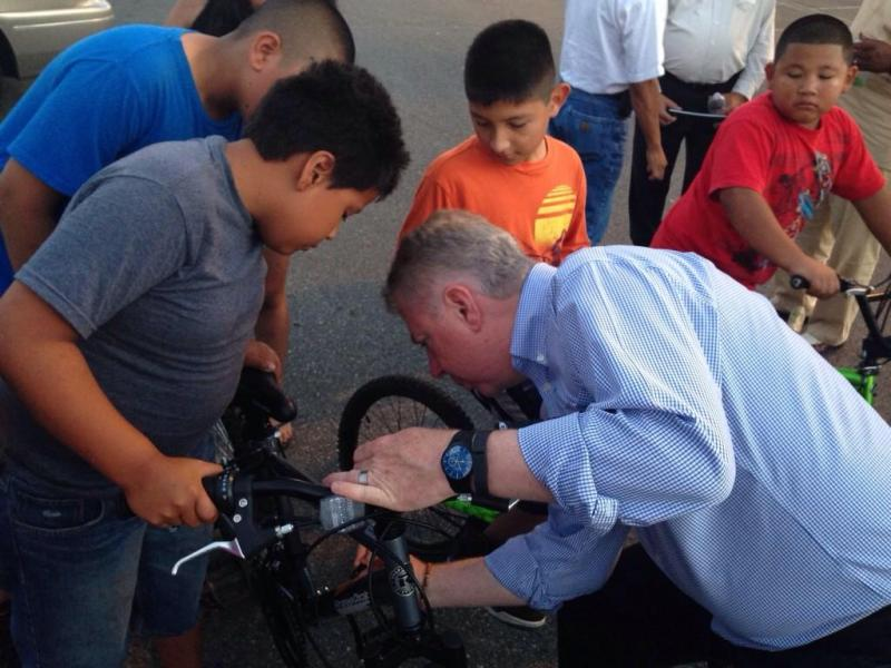 "Seattle Mayor Ed Murray signs kids' bike during a recent ""Find It, Fix It"" walk in south Seattle."