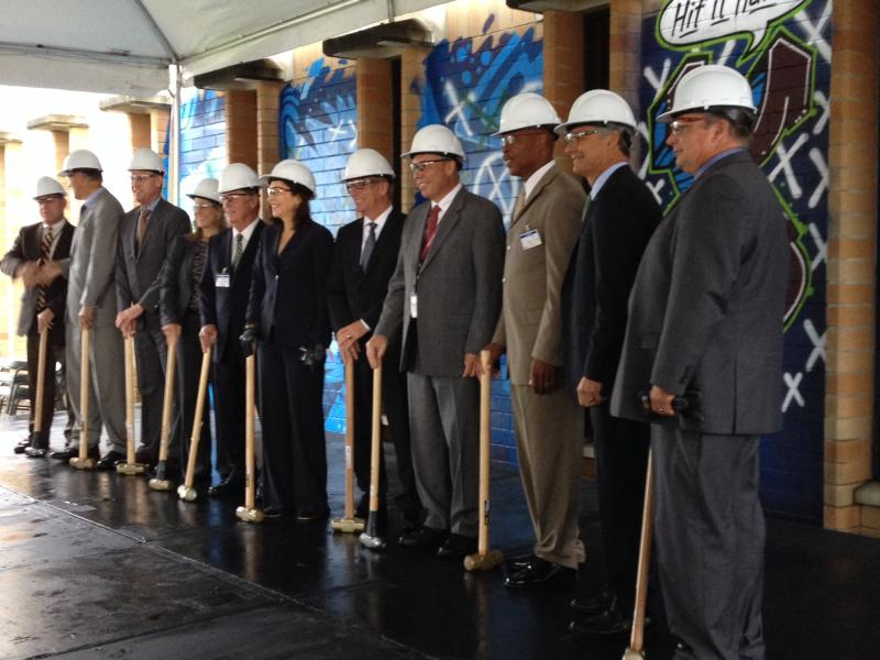 Officials including Sen. Maria Cantwell (center) and Boeing Commercial Airplanes CEO Ray Conner (second from right) get ready to begin demolition work.