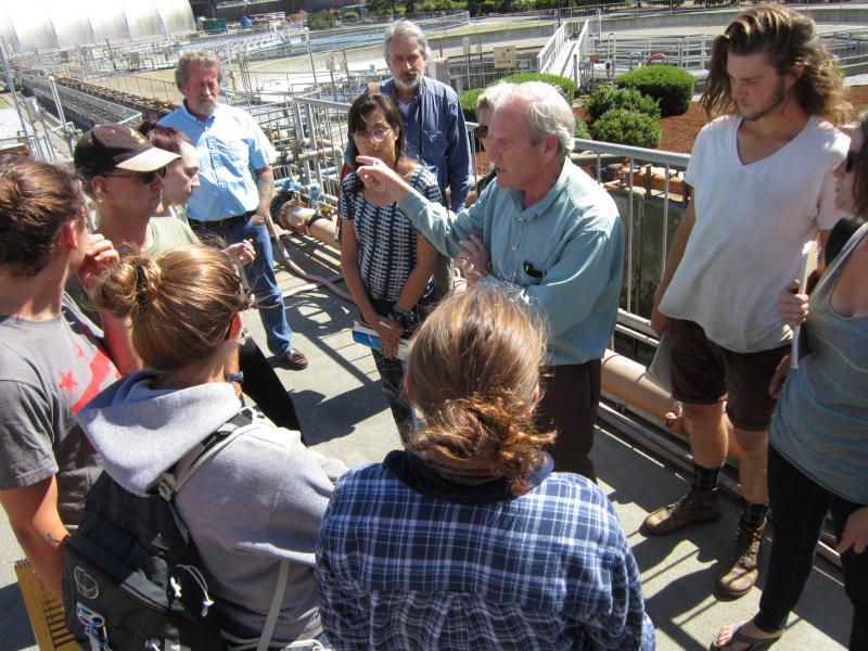 The City of Tacoma's Dan Thompson leads the students on a tour of the wastewater treatment facility.