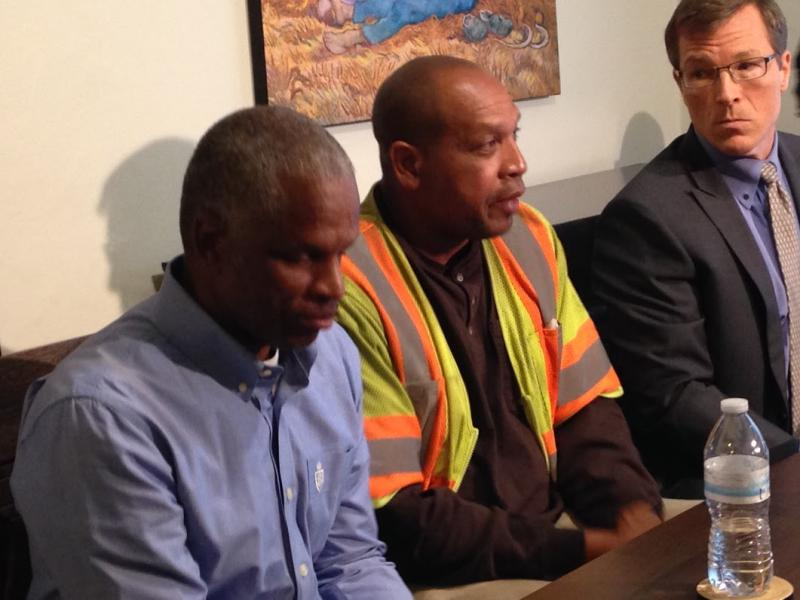 Reginald Wright, Rashad Pearson and attorney Stephen Teller at news conference in Seattle.