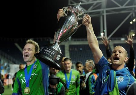 Seattle Sounders celebrate with the championship trophy at the end of the U.S. Open Cup final against the Philadelphia Union on Tuesday in Chester, Pa. The Sounders FC beat the Union 3-1 in overtime.