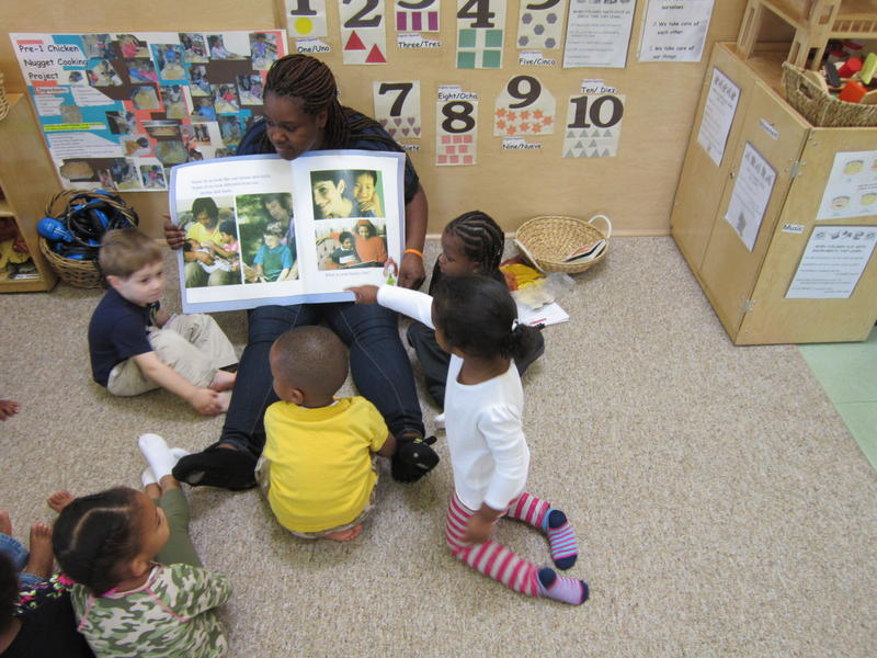 A preschool teacher reads to her students at Genesee Early Learning Center in Seattle.