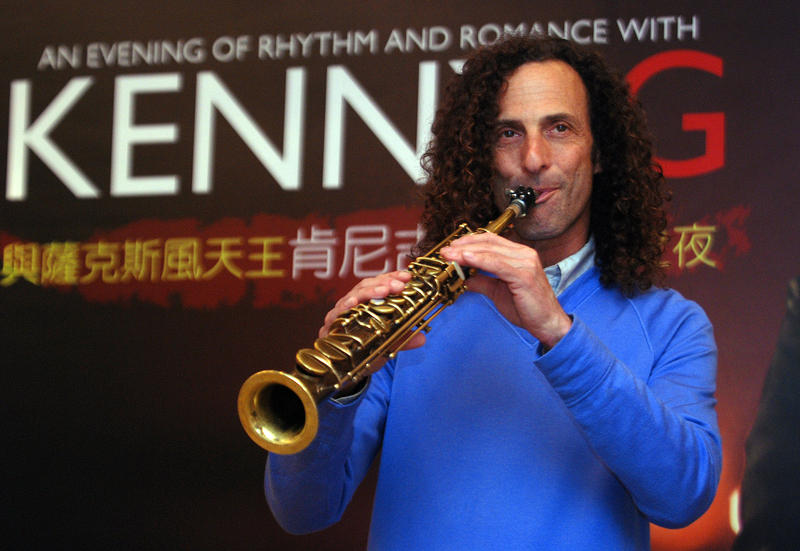 FILE - Kenny G, smooth jazz saxophonist, performs during a media event announcing his concert, Friday, May 14, 2010, in Taipei, Taiwan.