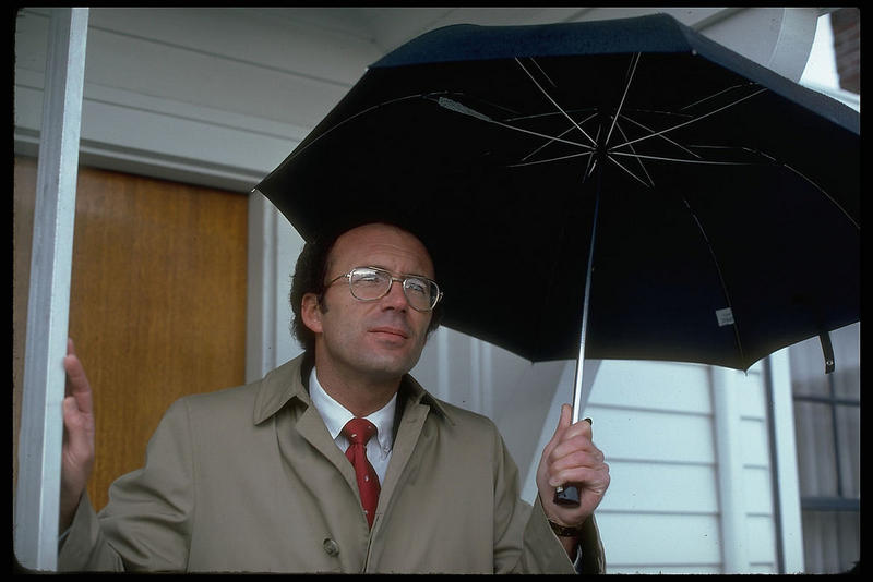 """Man with umbrella, 1980s"""