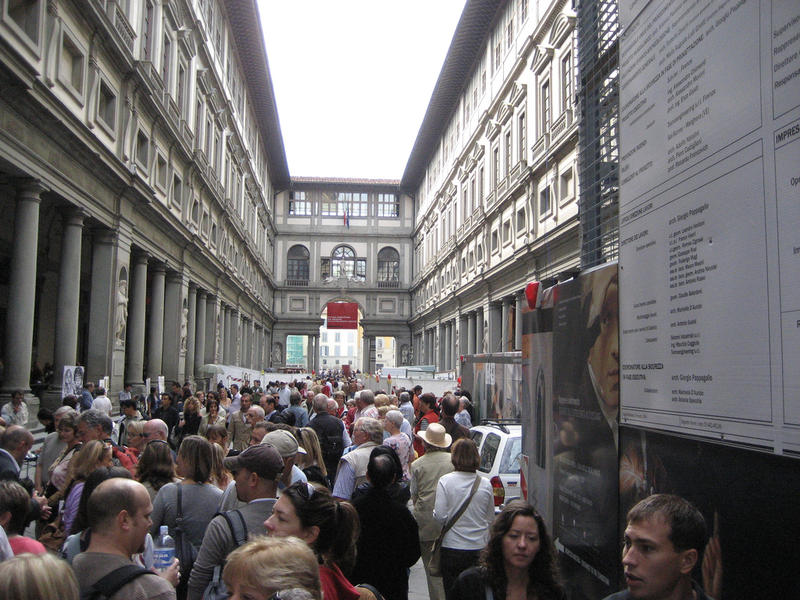 Crowds wait in line to get into the Uffizi Gallery museum in Florence, Italy.