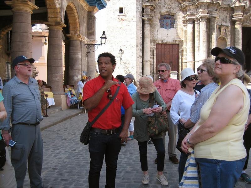 Havana tour guide Alejandro Infantes leads visitors through Cuba's capital city.