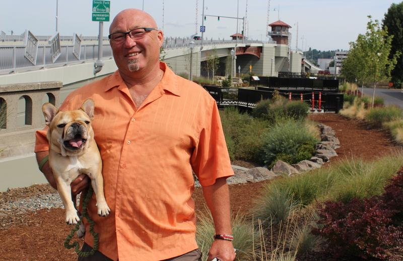 Jeff Hayes, a long time South Park resident and a retired Captain with the Seattle Fire Department, with his dog, Little Miss Sunshine. Hayes says Seattle Police are not doing enough to fight crime in the neighborhood.