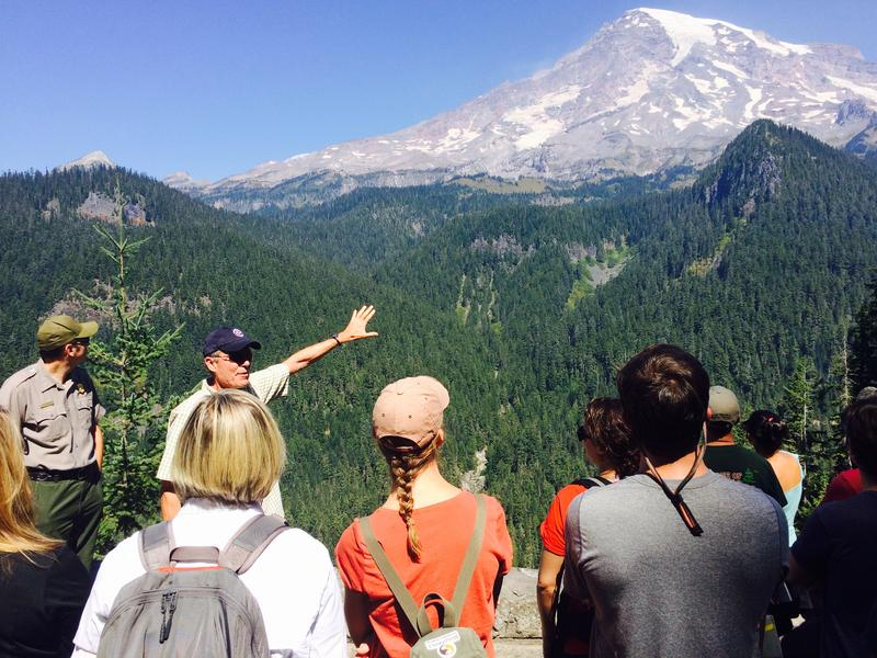 National Park Service Geomorphologist Paul Kennard shows 2015 Climate Boot Camp participants how far and fast Mt Rainier's glaciers are retreating.
