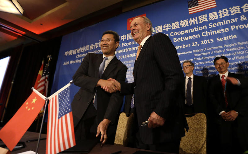 Zhimin Qian, President of China National Nuclear Corp, left, shakes hands with Lee McIntire, CEO of TerraPower, following a signing ceremony linking the two organizations at a U.S. Trade and Investment Cooperation Conference Tuesday.