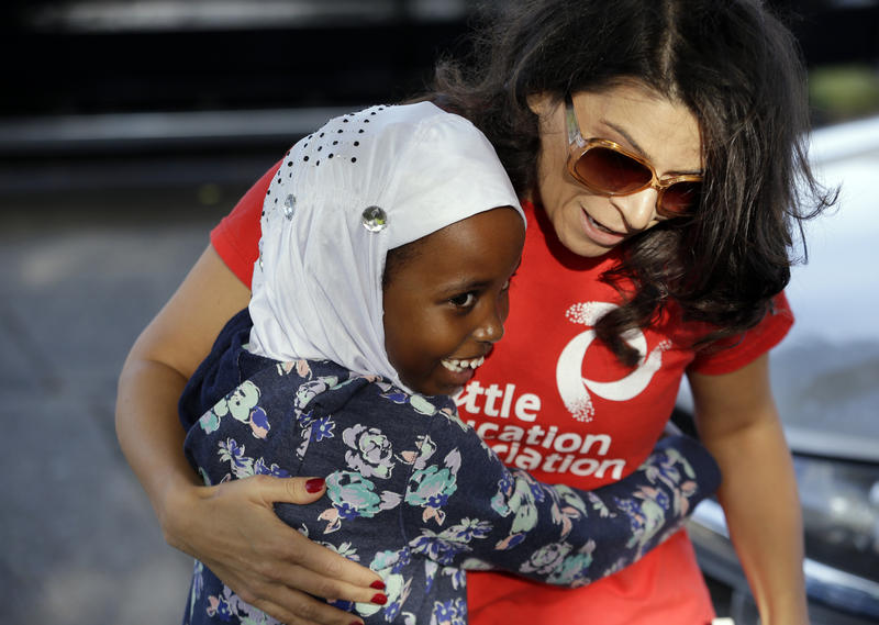 First grade student Halima Said, 6, meets her new teacher, Amber Simonton, for the first time on the picket line where Simonton joined other teachers Wednesday morning, Sept. 9, 2015