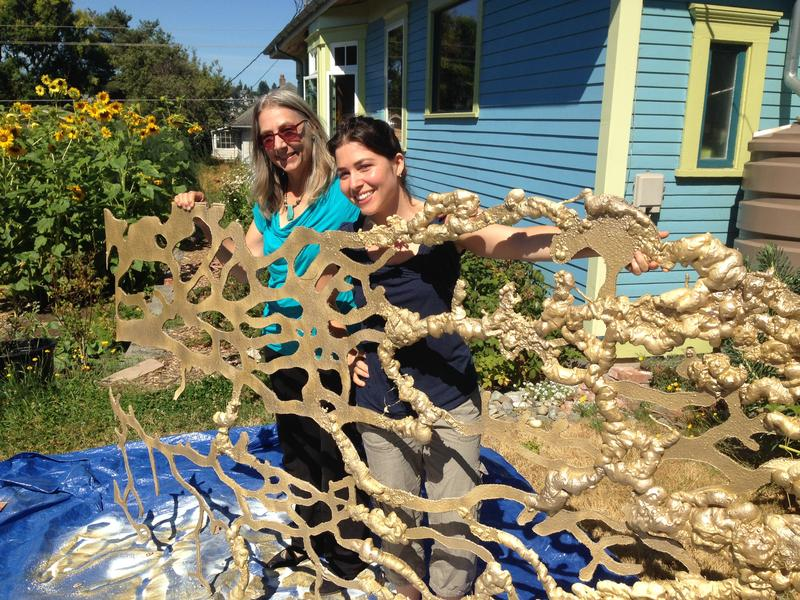 Mele's mom helps show this larger-than-life cardboard slime mold/