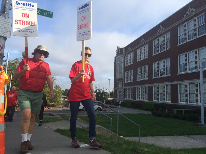 Picketers supporting the striking Seattle Education Association march in front of Garfield High School in Seattle's Central District neighborhood. The teachers strike will stretch into at least a second day, the district announced Wednesday.