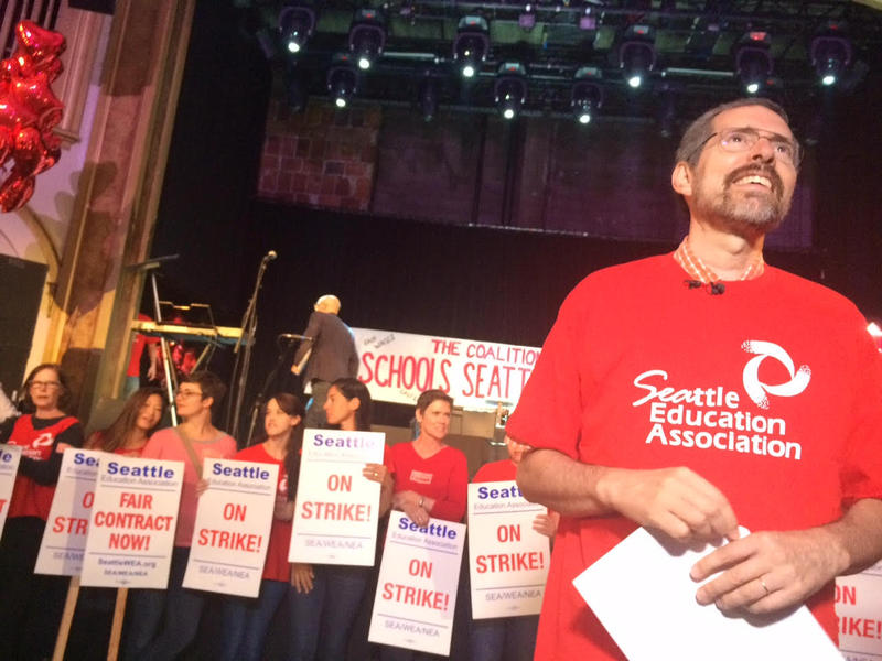 Seattle Education Association president Jonathan Knapp prepares for a press conference before a benefit concert for striking teachers at The Neptune in Seattle's University District.