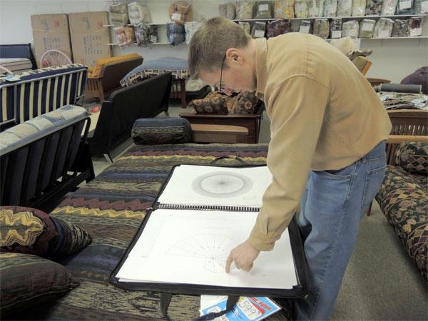 Jason Padgett with drawing at his dayjob