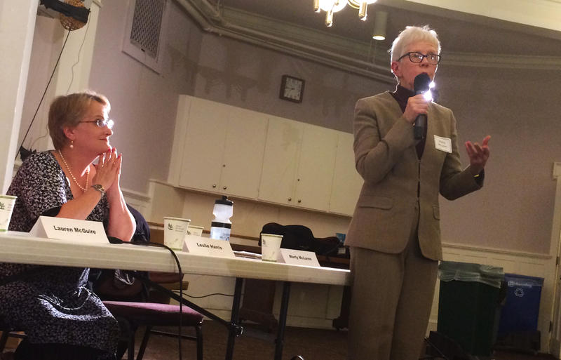 Marty McLaren, right, speaks during a school board candidate forum at Seattle First Baptist Church in October. Her opponent Leslie Harris, left, is looking on.