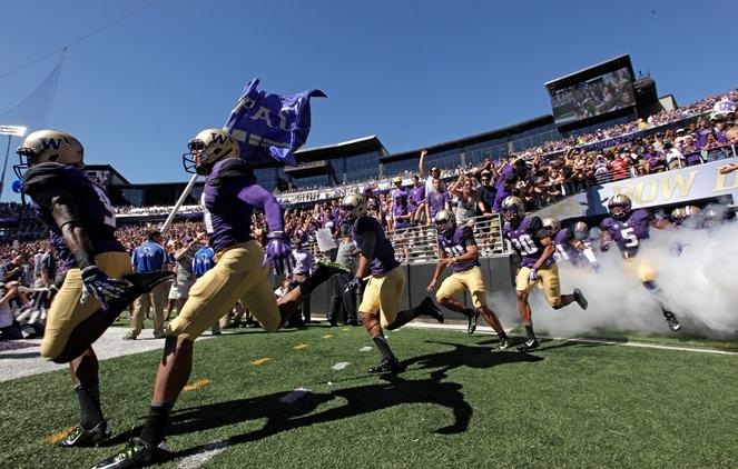 UW players run out of the tunnel at for a game against Utah State, Saturday, Sept. 19, 2015, in Seattle.