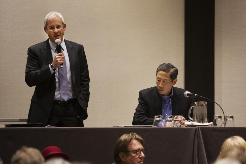KPLU General Manager Joey Cohn and Community Advisory Committee Chairman Stephen Tan address a public meeting about the sale of KPLU.