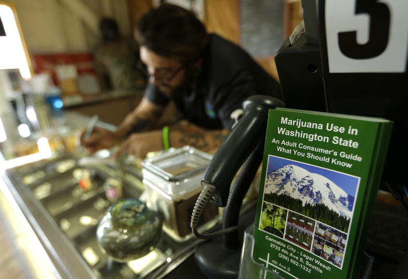 A pamphlet discussing marijuana use in Washington state is shown on a counter at Cannabis City, Tuesday, July 7, 2015, in Seattle.