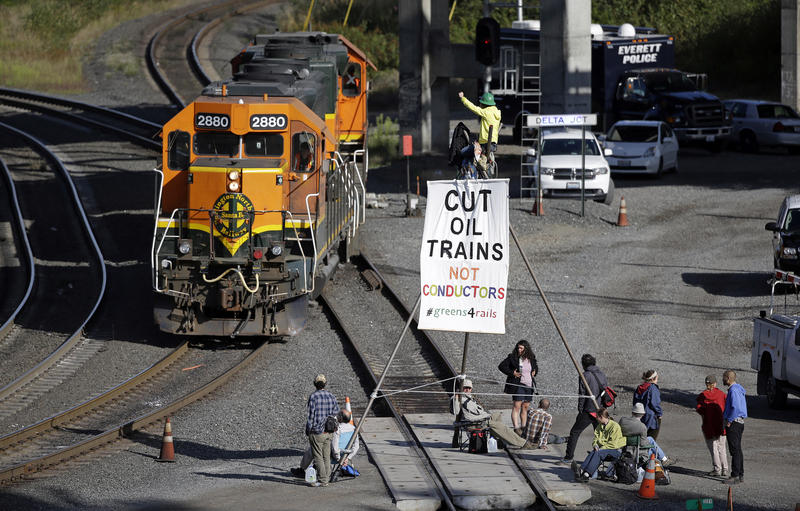 About a dozen demonstrators blocked the tracks at a Burlington Northern Santa Fe yard to protest oil trains.