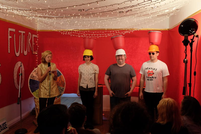 Claire Buss as host Clay Buff with contestants from the Seattle rock band Wimps.