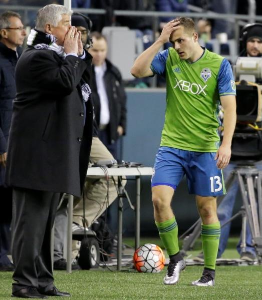 Sounders forward Jordan Morris, right, walks past head coach Sigi Schmid after being subbed out in the second half of a CONCACAF Champions League soccer quarterfinal against Club America, Feb. 23, 2016, in Seattle.