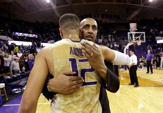 UW head coach Lorenzo Romar embraces Andrew Andrews after their final regular season game Wednesday, March 2, 2016, in Seattle. Andrews led all scorers with 47 points and Washington beat Washington State 99-91.