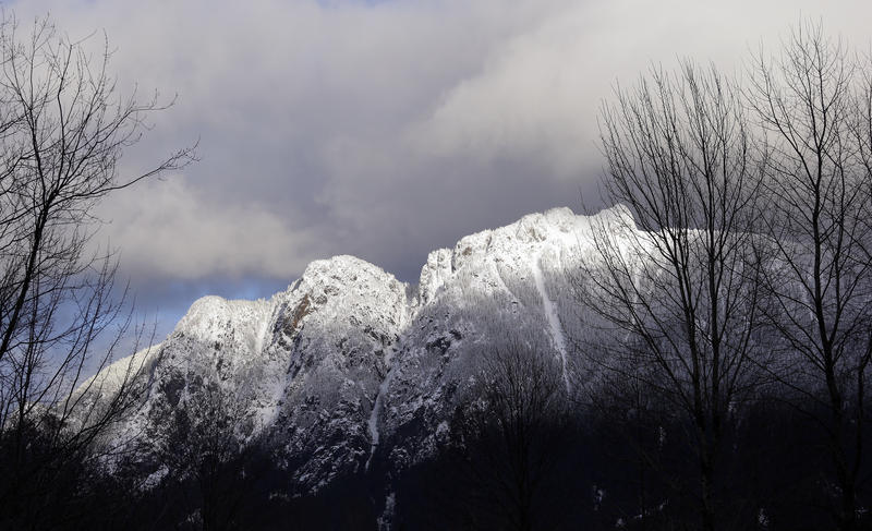 The sun briefly shines on Mount Si and a layer of freshly-fallen snow last December on the 4,167-foot Cascade mountains peak in North Bend, Wash.
