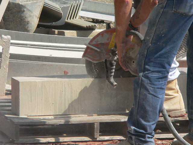Cutting stone and concrete releases silica particles, which can lodge in workers' lungs, causing permanent damage.