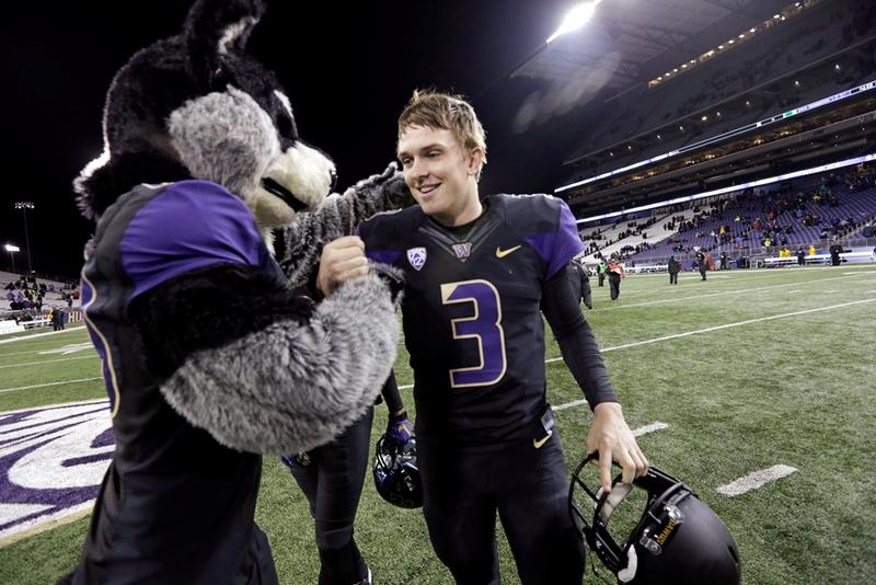 Washington quarterback Jake Browning (3) is greeted by team mascot Harry the Husky after the team beat Arizona in an NCAA college football game Saturday, Oct. 31, 2015, in Seattle. The Huskies will need to rely heavily on Browning's arm in 2016.