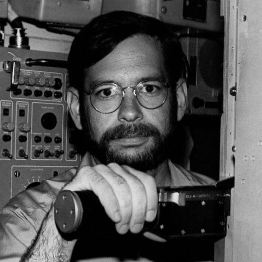 Naval officer Tom Rogers at a submarine periscope circa 1980.