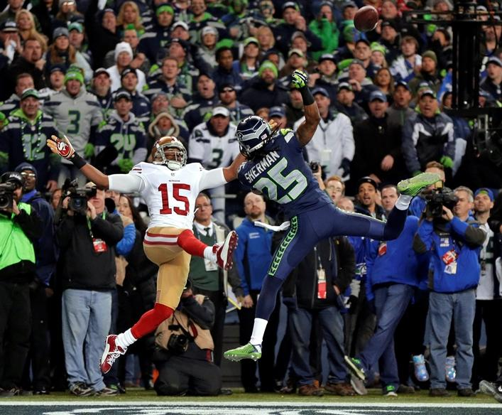 Seattle Seahawks' Richard Sherman (25) tips a pass in the endzone intended for San Francisco 49ers' Michael Crabtree (15) in the final minute of the second half of the NFC championship NFL football game in Seattle on January 26, 2014.