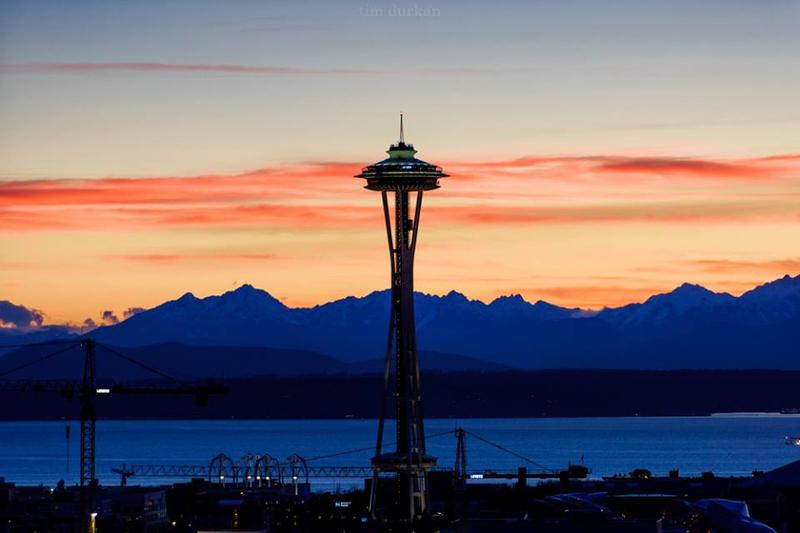 The sunset provides a burst of color behind Seattle's Space Needle on March 28th, 2016.