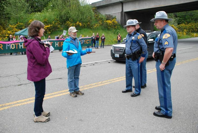 Chris Warmedahl and Tom Rogers offering cookies to the State Patrol officers at Naval Base Kitsap-Bangor on Mothers Day 2014.