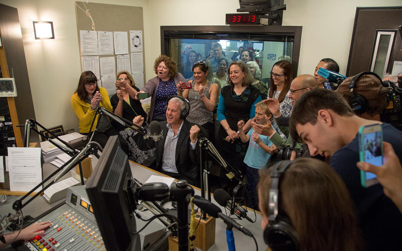 KPLU General Manager Joey Cohn, surrounded by KPLU staff and local media, announced that the Save KPLU campaign has hit its fundraising goal.