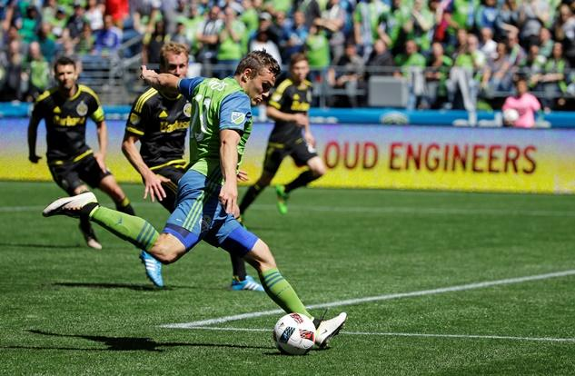 Seattle Sounders' Jordan Morris makes a shot on goal against the Columbus Crew in the second half of an MLS soccer match, Saturday, April 30, 2016, in Seattle. The Sounders beat the Crew 1-0.