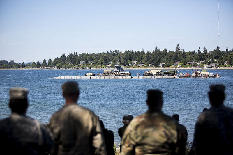 The Washington National Guard watch as equipment arrives to Jensen Point on Vashon Island. The event is a part of the Cascadia Rising earthquake drill that began Tuesday and lasts through Friday June 10.