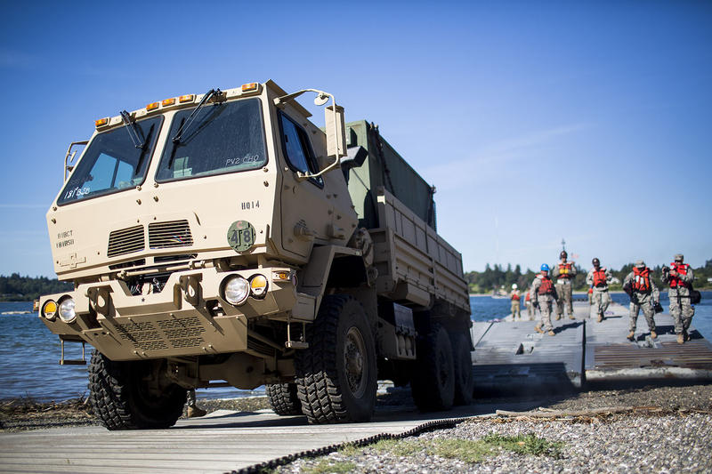 An Oshkosh truck disembarks the barge onto Jensen Point. The Washington National Guard would help bring food, medicine and other supplies to Vashon in case ferry service to the island is disrupted as a result of a natural disaster.