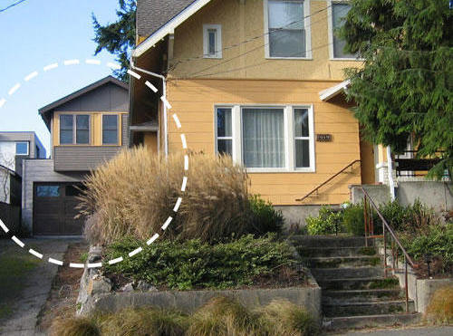 The circle in this image provided by Seattle City Councilman Mike O'Brien's office highlights an example of a backyard cottage in Ballard.