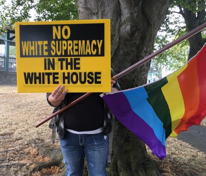 Protester at anti-Trump event in Clark Park in  Everett.