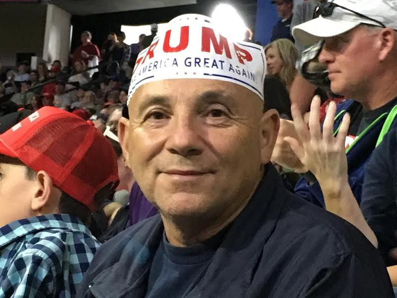 Trump supporter Carlos Gutierrez, who lives in Marysville and works at Boeing, at a rally in Everett.