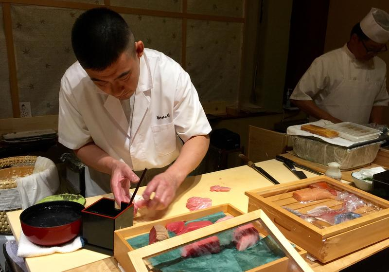 Kotaro Kumita tends to his fish and his guests, at the sushi bar at Wataru, in Ravenna.