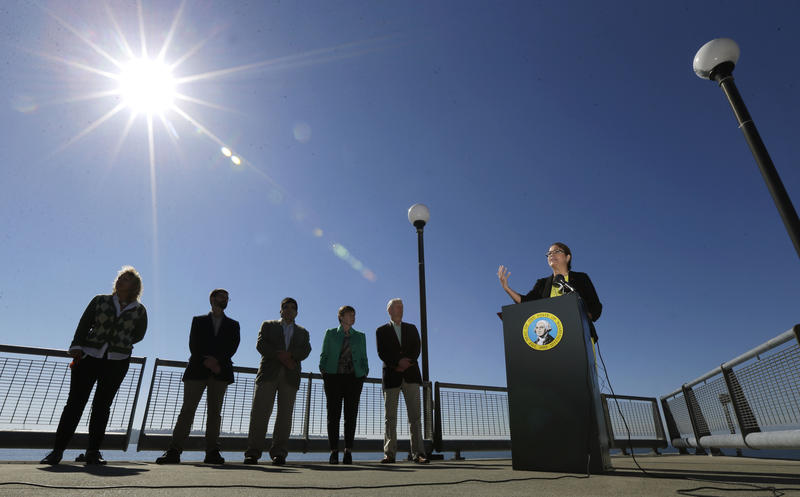 Maia Bellon, right, director of the Washington State Dept. of Ecology, speaks at a press conference, Thursday, Sept. 15, 2016, overlooking Elliott Bay in Seattle.